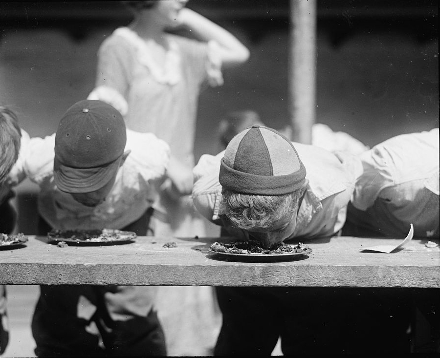 (Pie-eating contest at the Jefferson School in Washington, DC, August 2, 1923 | National Photo Company Collection)