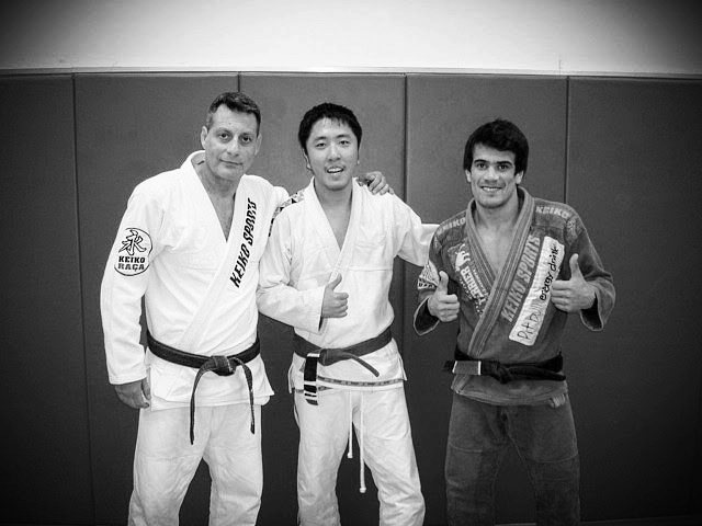 """In 2008, I met Romero """"Jacare"""" Cavalcanti (left) and Rubens """"Cobrinha"""" Charles Maciel (right) in Atlanta, Georgia. Little did I know then that in meeting Cobrinha, I was meeting my future instructor, mentor, and the person to finally promote me in BJJ."""