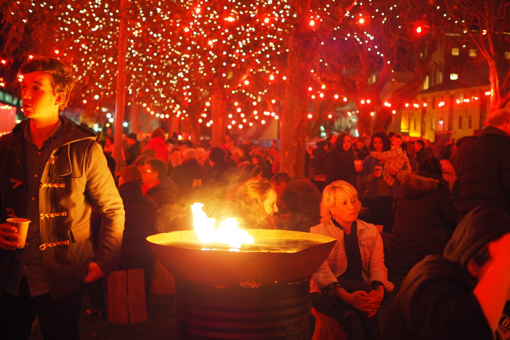 The fire pits of the Winter Feast are a warming hub at dark arts Mofo
