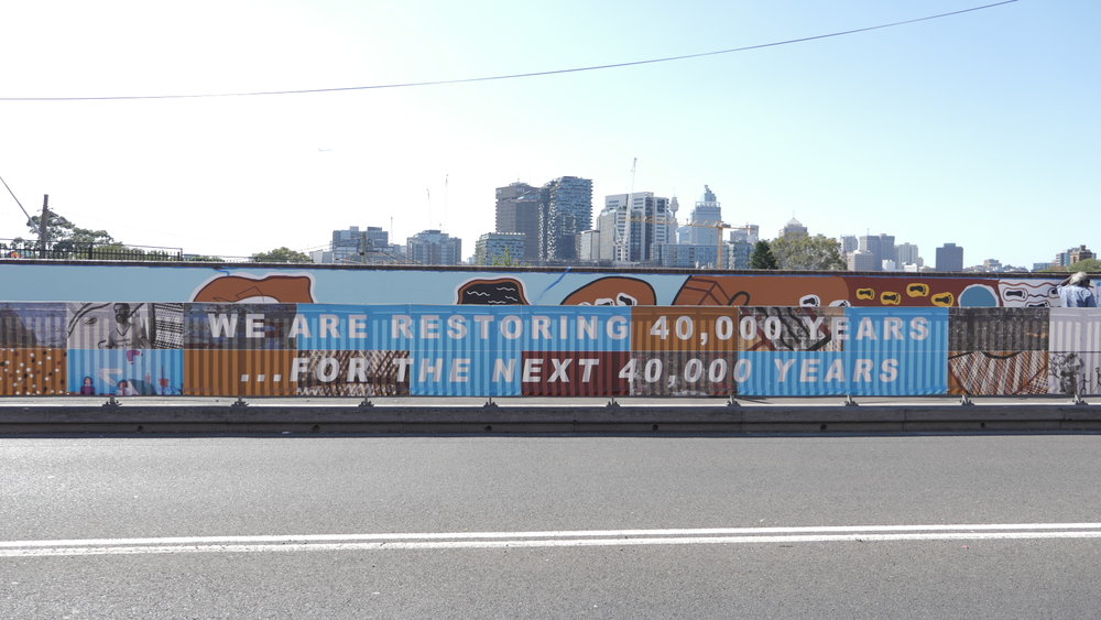 Upgrade banners adorned the wall opposite Redfern station for over a month. Photo by Lily Keenan