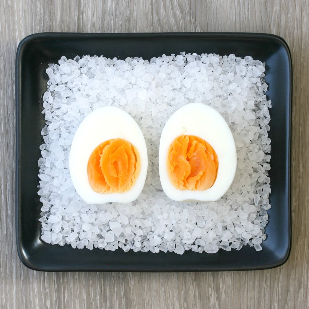 8 minutes: whites softly set; yolks set but quite 'fudgy'.