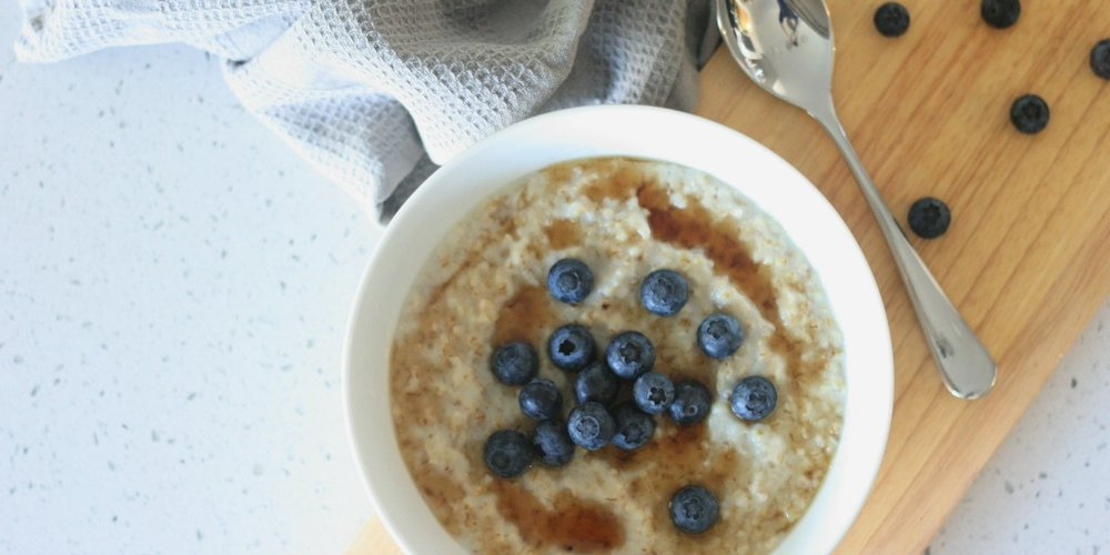 Steel cut oat porridge made in the steam oven, served with maple syrup and fresh blueberries