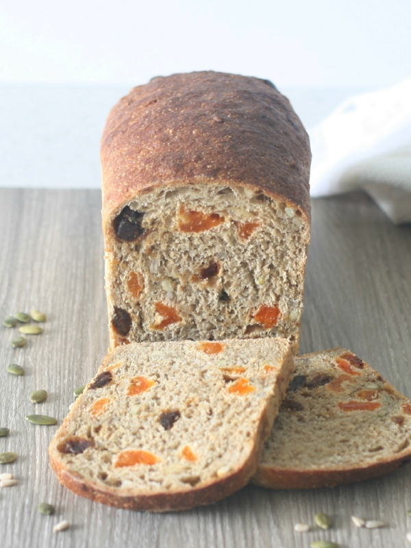 Apricot, date and seed bread baked in a combi steam oven, with two slices cut from the loaf