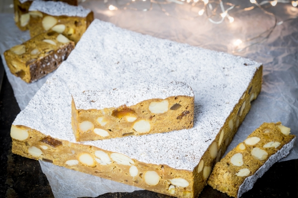 Ginger, apricot and macadamia panforte, cut into slices for serving.