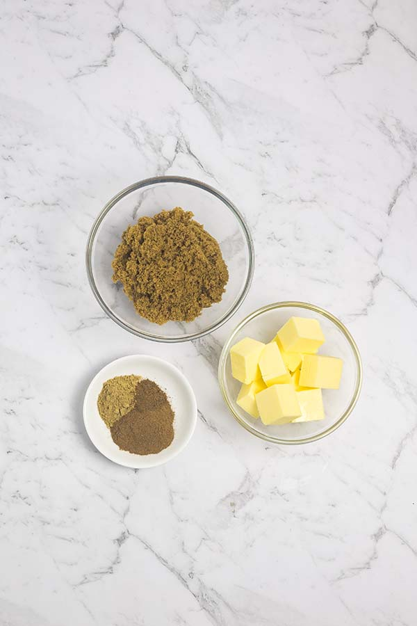 Ingredients laid out for twisted cinnamon bread filling. Spices, brown sugar, butter.