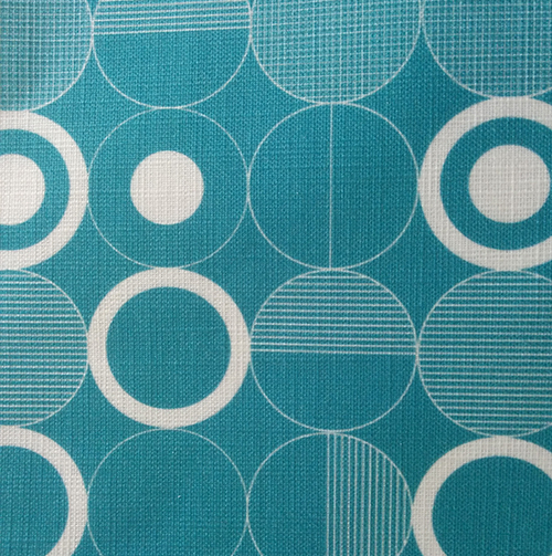 Ronda 003    Shown here printed onto a textured linen, this design is inspired by graphic circles.  Available in other colours.