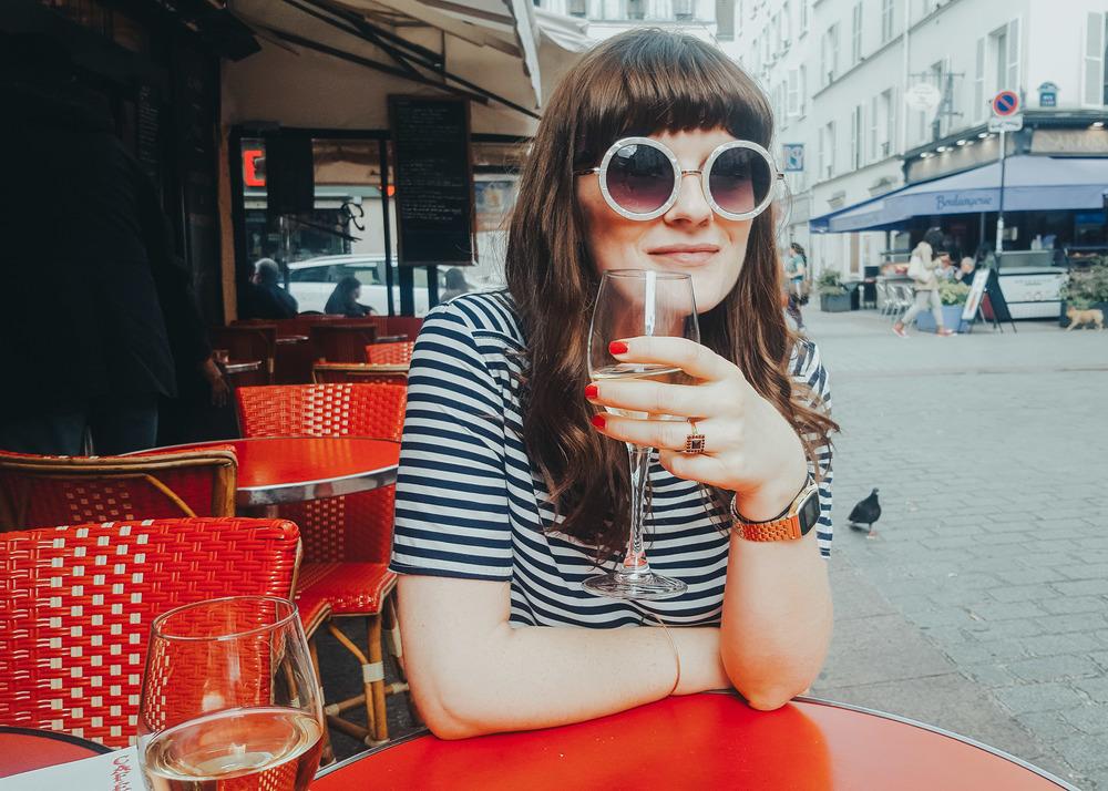 Girl drinking wine in Paris