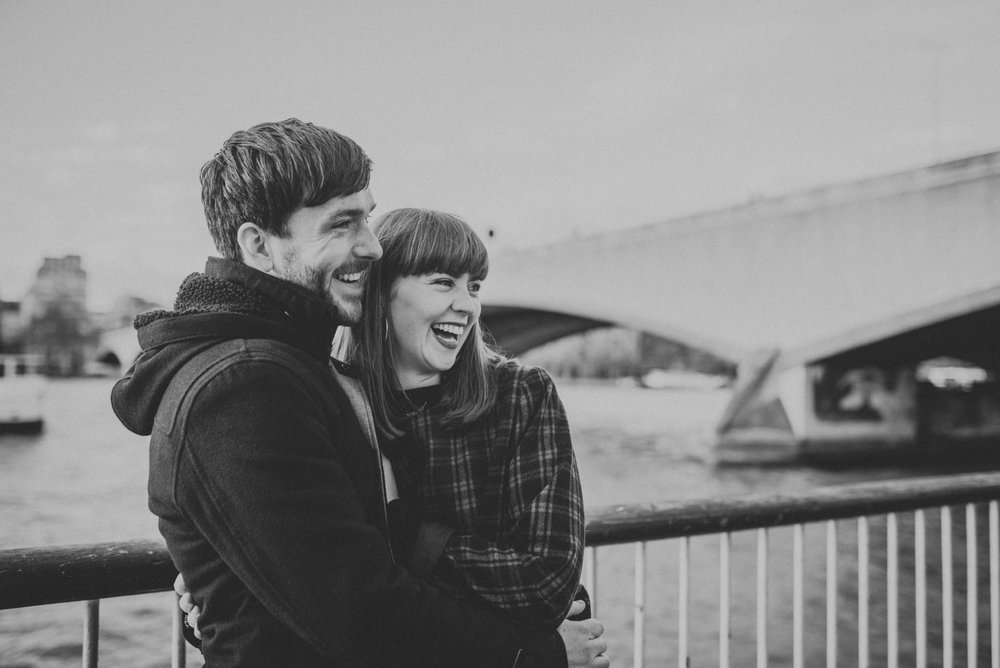 Couple laughing by the River Thames