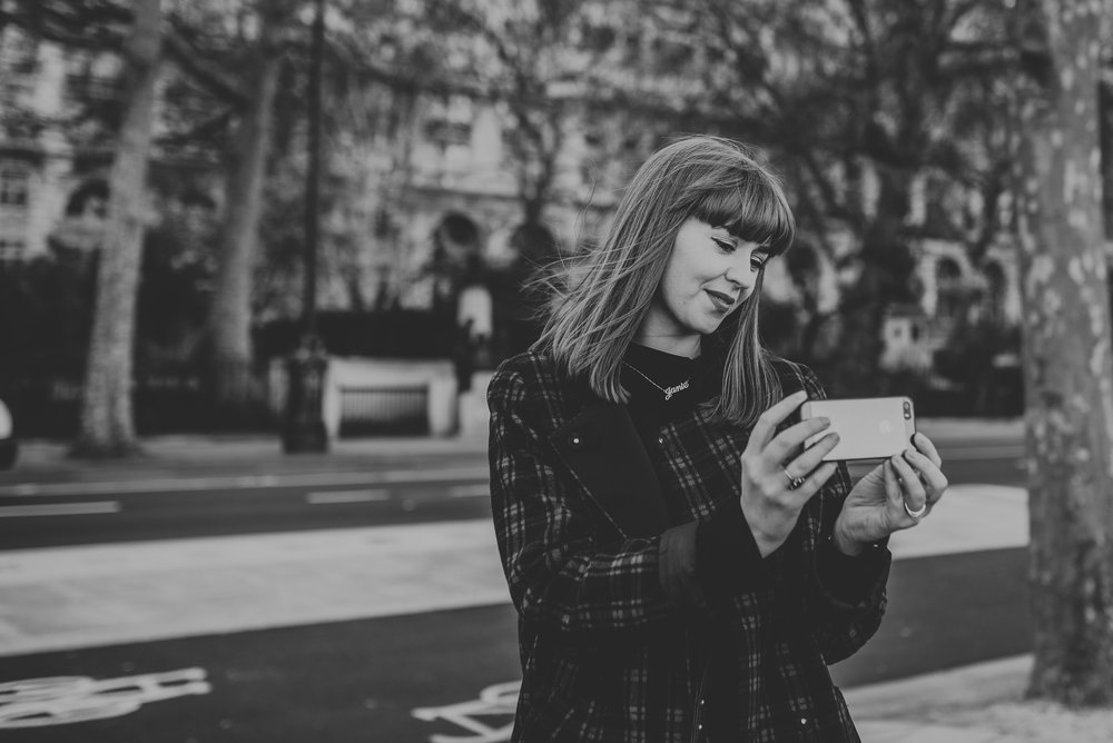 Girl taking picture with smartphone