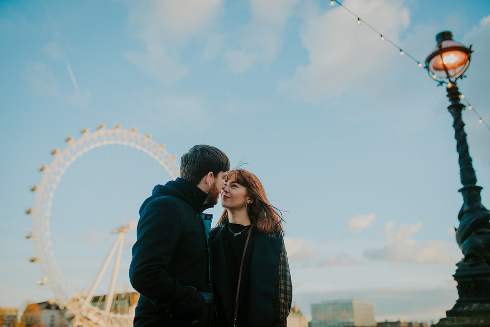 Couple in love in front of the London Eye