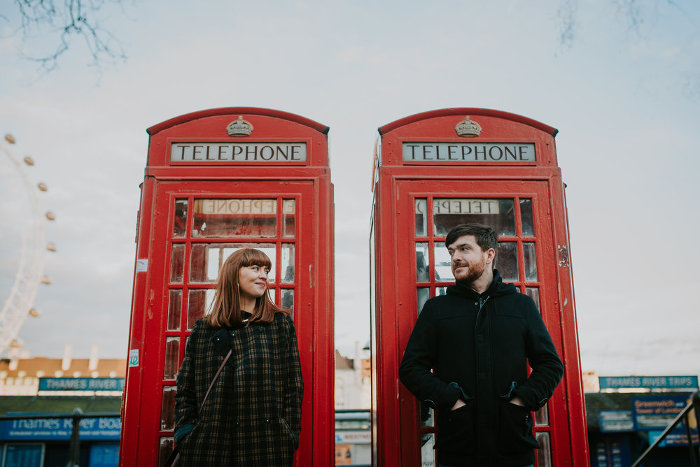 Engagement photo with red phone boxes London