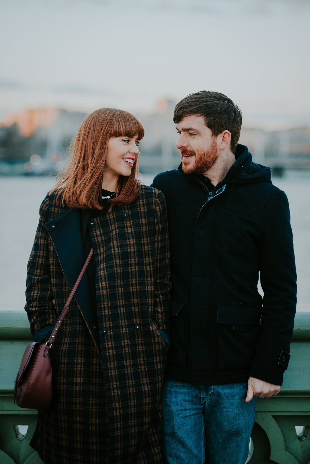 Engaged couple in love on Westminster Bridge London