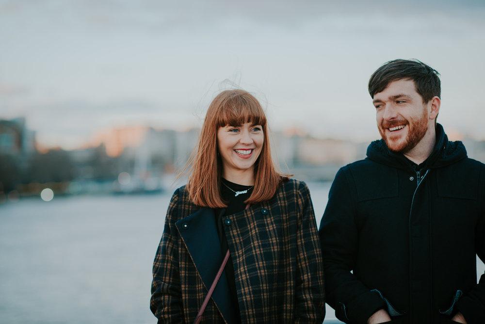 Engaged couple laughing on Westminster Bridge London