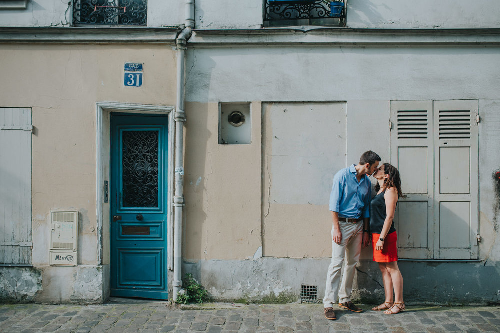 Paris engagement shoot couple in love kissing on Montmartre street