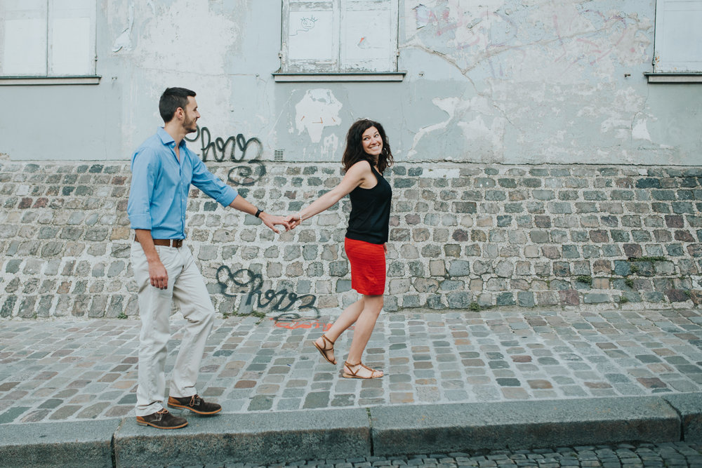 Paris engagement shoot couple in love walking on Montmartre street