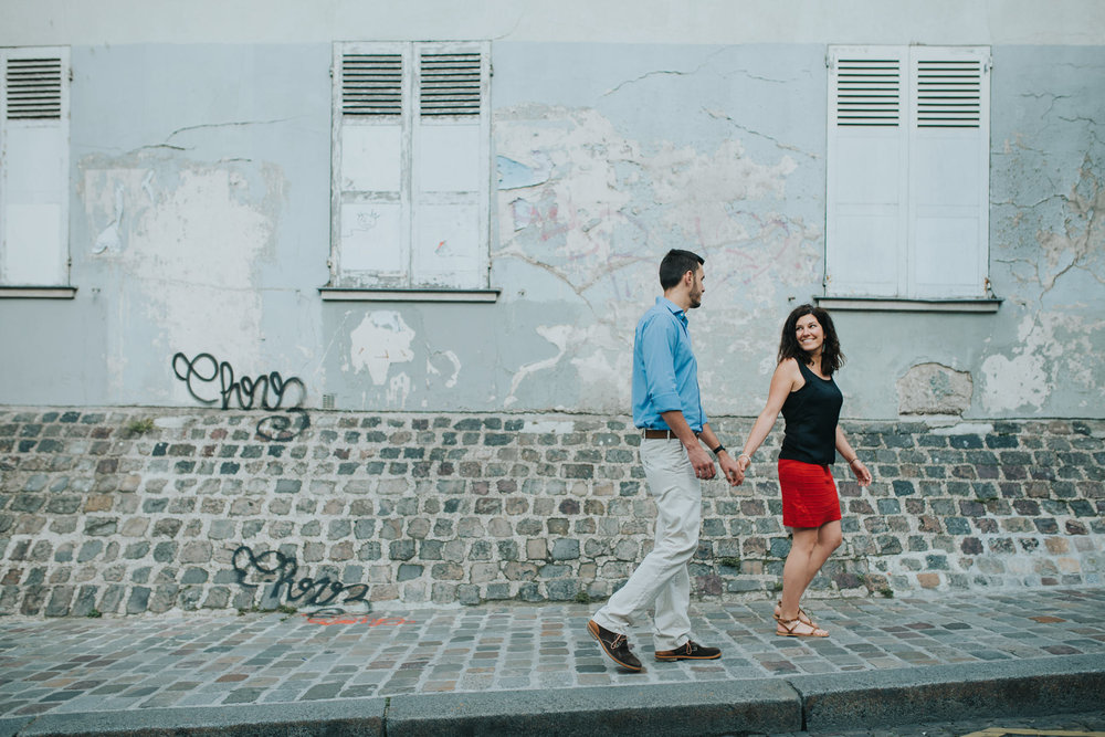 Paris pre-wedding shoot couple in love walking in Montmartre