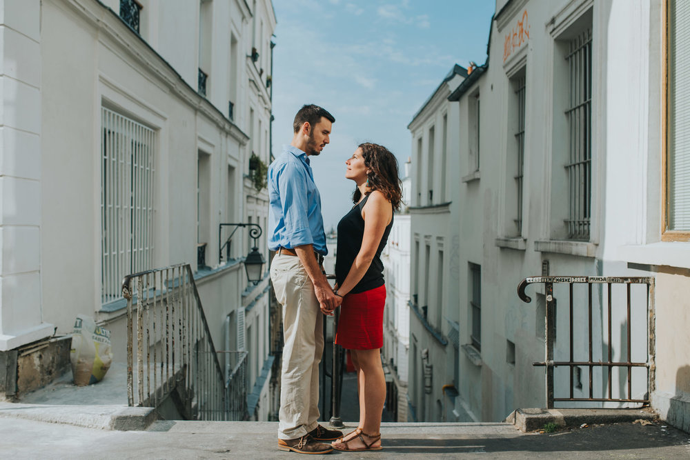 engaged couple in love standing in front of Parisian architecture