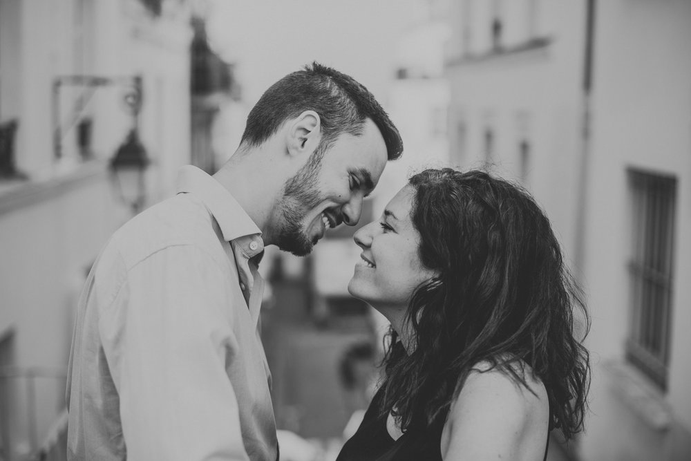 Paris couple shoot black and white image of couple in love kissing