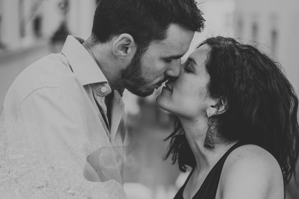 Close up black and white image of couple in love kissing