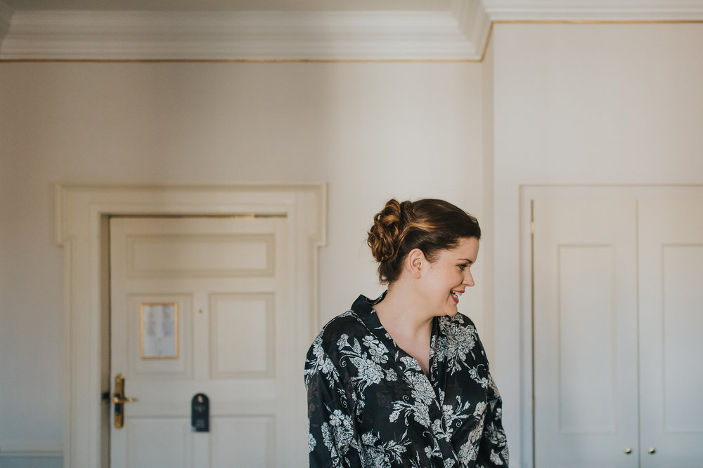 bride getting ready on her wedding day at Merrion Hotel Dublin