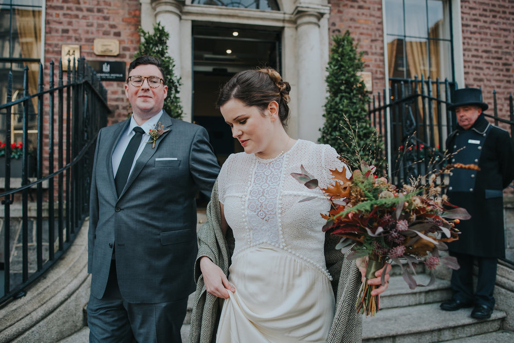 Bride and groom leaving the Merrion Hotel Dublin on their wedding day