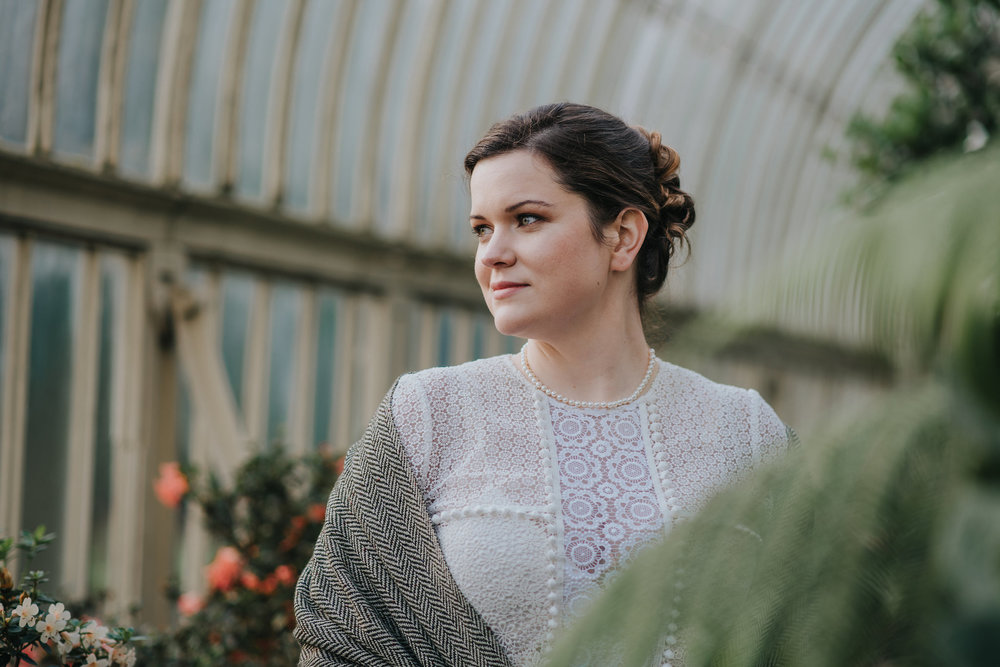 Portrait of bride in greenhouse at Botanic Gardens Dublin on her wedding day