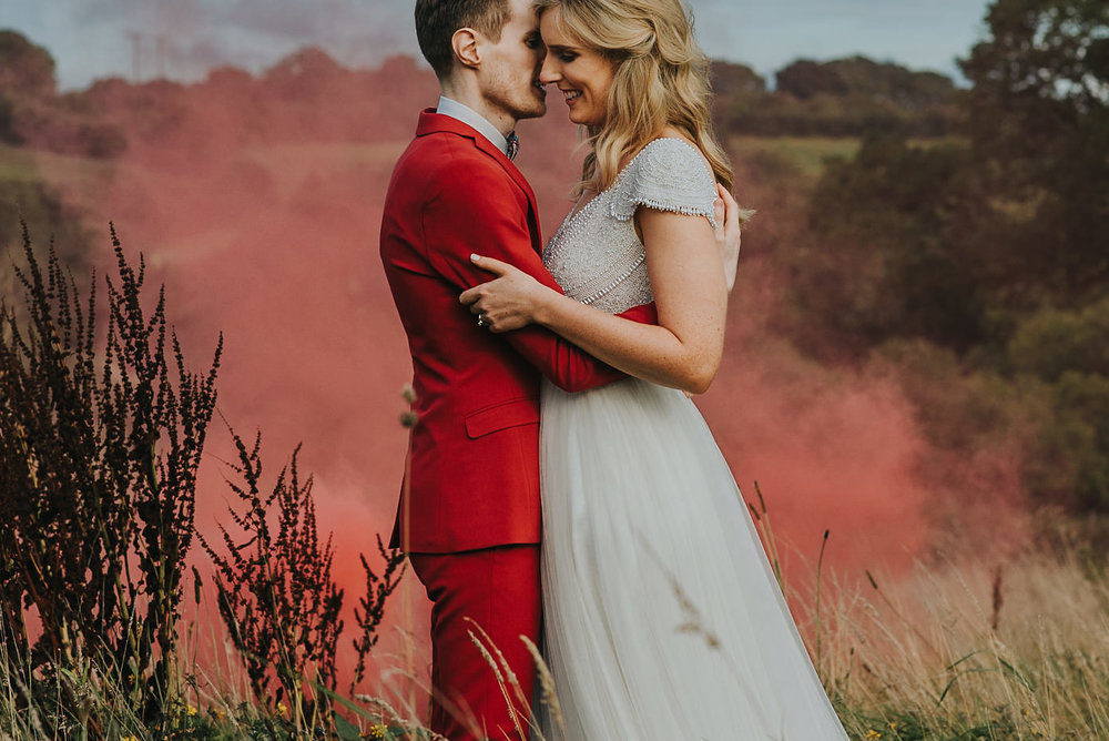 Bride and Groom with smoke bomb