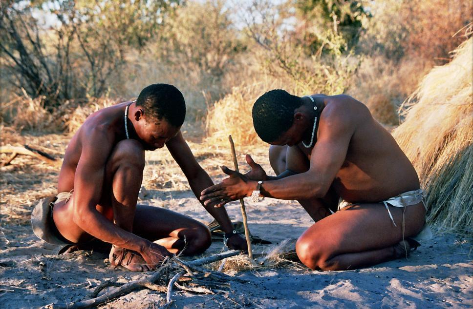 Bushmen in Deception Valley, Botswana demonstrating how to start a fire by rubbing sticks together. Image courtesy of Isewell (CC License - Attribution-Share)