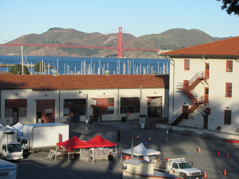 Setting up the Fort Mason Center Farmers' Market with a view of Golden Gate Bridge