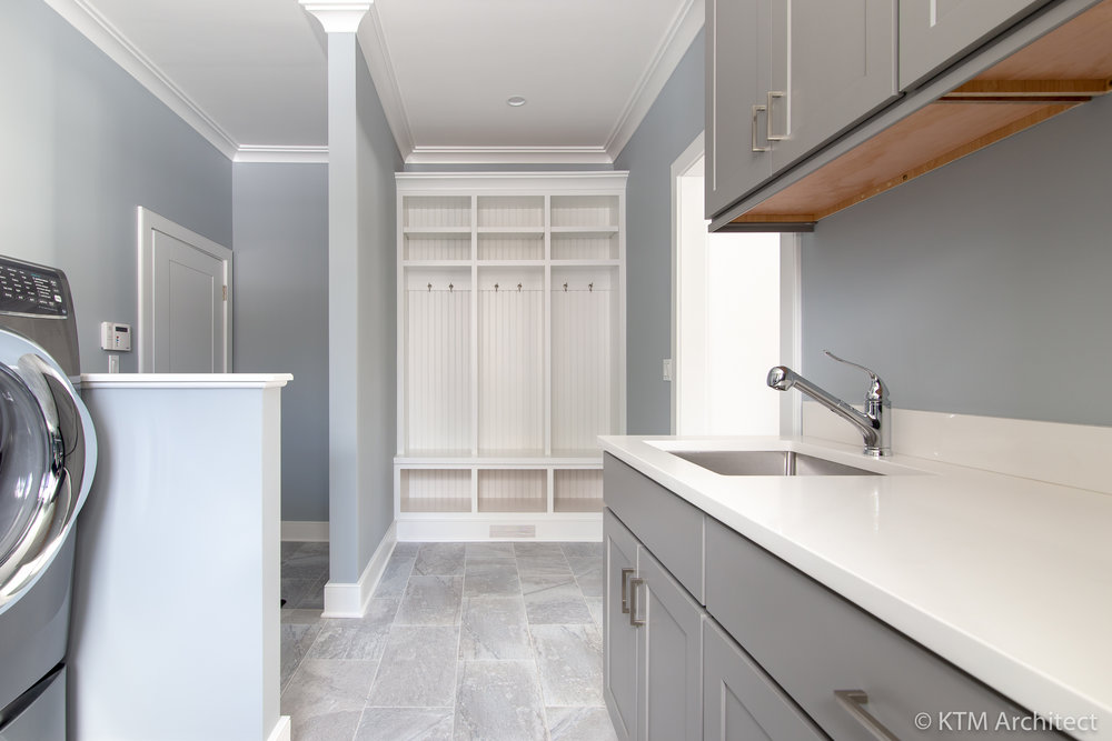 The closet nook allows jackets, bags and shoes to be dropped off prior to entering the kitchen and yet they stay out of sight.
