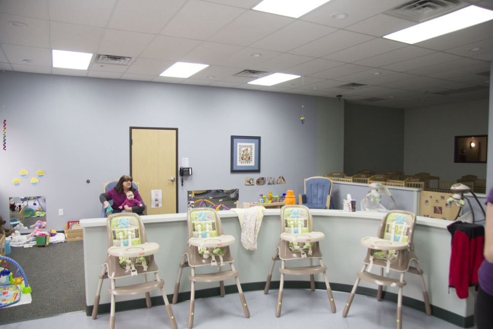 the tlc nursery has an open play area, a full kitchen with breast milk storage abilities, and a separate crib area. all visitors are asked to remove their shoes before entering the nursery.