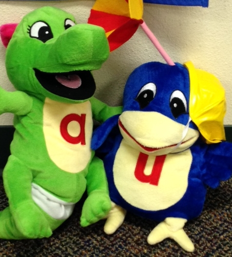 Allie the alligator puppet and umber the Umbrella Bird from Amanda's TLC preschool classroom
