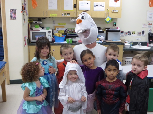 TLC kiddos have fun with Executive Director Matt Eldred on Halloween last year. Kids are welcome to bring their costumes on Monday, October 31st, for a TLC Costume Parade.