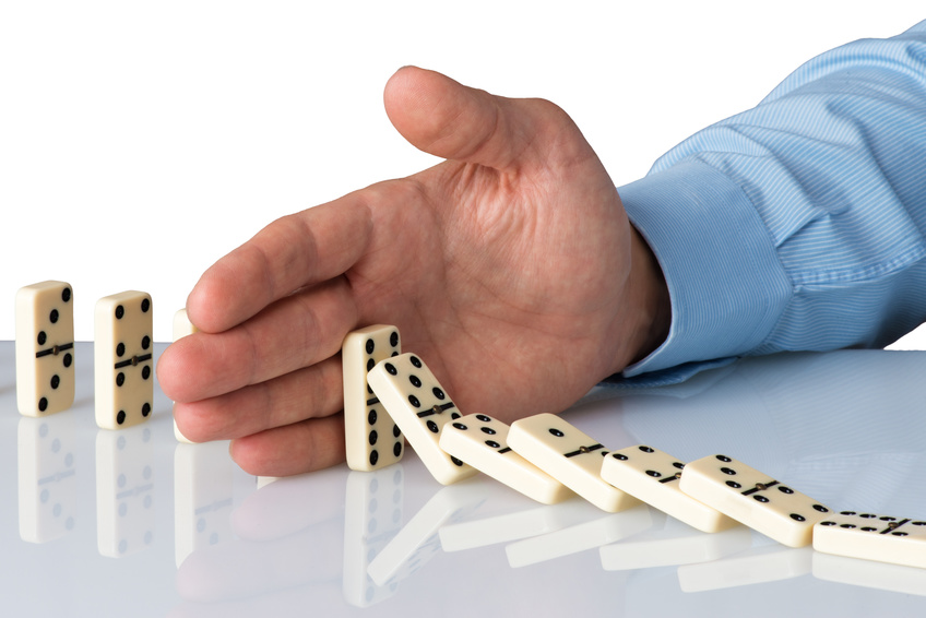 hand stopping domino falling sequence
