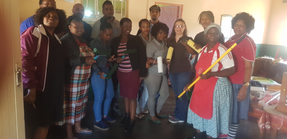 RPC Astrapak JJ Precision embraced the opportunity to gather volunteers for a worthy project on Mandela Day, exercising our Core Values of TEAMWORK and RESPECT. Far left: Mrs Lungile Shabangu (Manager of J-Ndwalane (Marianhill) Pre-School), behind her is Zakhele Myeza (JJ Precision General Manager); centre of photo with grey trousers and shirt is Quality Controller Lindiwe Luthuli.  JJ Precision team front from left: Thulile Shabangu; Zanele Nxele; Bongekile Zuma; Ncamisile Ngubane; Lindiwe; Jessica Steyn; Nozipho Chamane; Samkelisiwe Manci; and back from left: Zak Myeza; Marven Geza; Simeon Daniel; Zizipo Moni; Ashton Ranjith; Themba Magcaba.