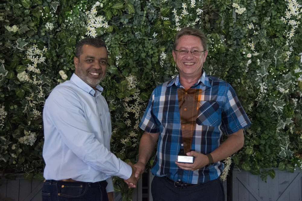 QUALITY: SHEQ Manager of the Year → Gert van der Berg [RPC Astrapak Group Procurement & Supply Executive Nawaaz Kalick awards the trophy to SHEQ Manager Gert van der Berg]