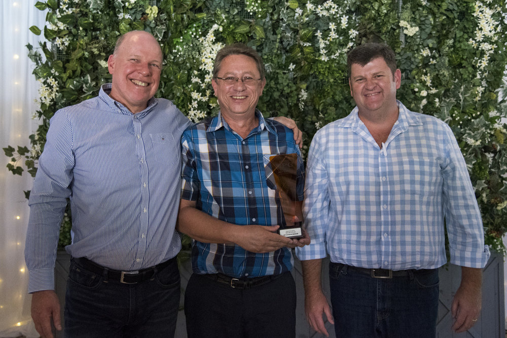 HEALTH & SAFETY: Best SHE Site → RPC Astrapak Marcom [RPC Astrapak CEO Robin Moore awards the trophy to SHEQ Manager Gert van der Berg and General Manager Gerhard van Reenen]