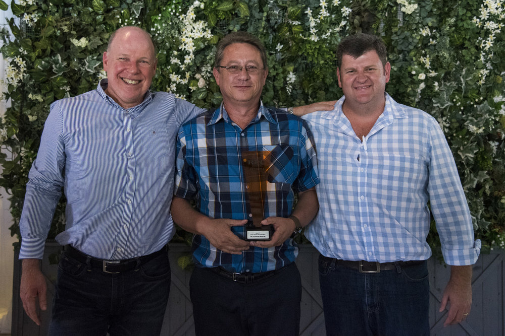 QUALITY: Best Site of the Year → RPC Astrapak Marcom [RPC Astrapak CEO Robin Moore awards the trophy to SHEQ Manager Gert van der Berg and General Manager Gerhard van Reenen]