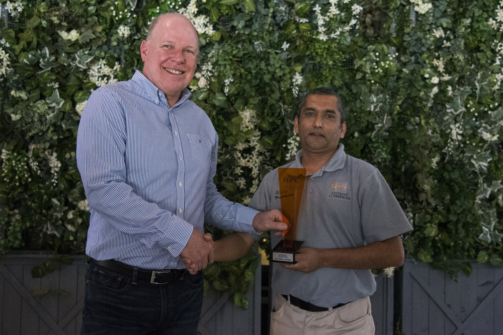 SUSTAINABILITY: Best Zero Waste to Landfill Site → RPC Astrapak JJ Precision [RPC Astrapak CEO Robin Moore awards the trophy to Quality Assurance Manager Nelash Harinarain]
