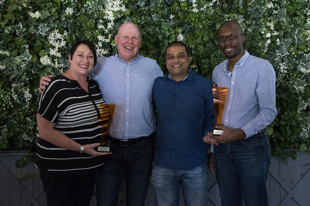 INNOVATION: Outstanding Collaboration between Site & Customer → RPC Astrapak Consupaq and Clicks South Africa [RPC Astrapak CEO Robin Moore awards the trophy to Key Account Manager Belinda van Pletzen on behalf of Clicks; and Consupaq's SHEQ Manager Mishan Lilruthan and Site Service Manager Trust Ndlela]