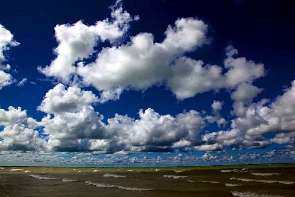 Clouds over Lake Huron. Photo copyright Christine Montague