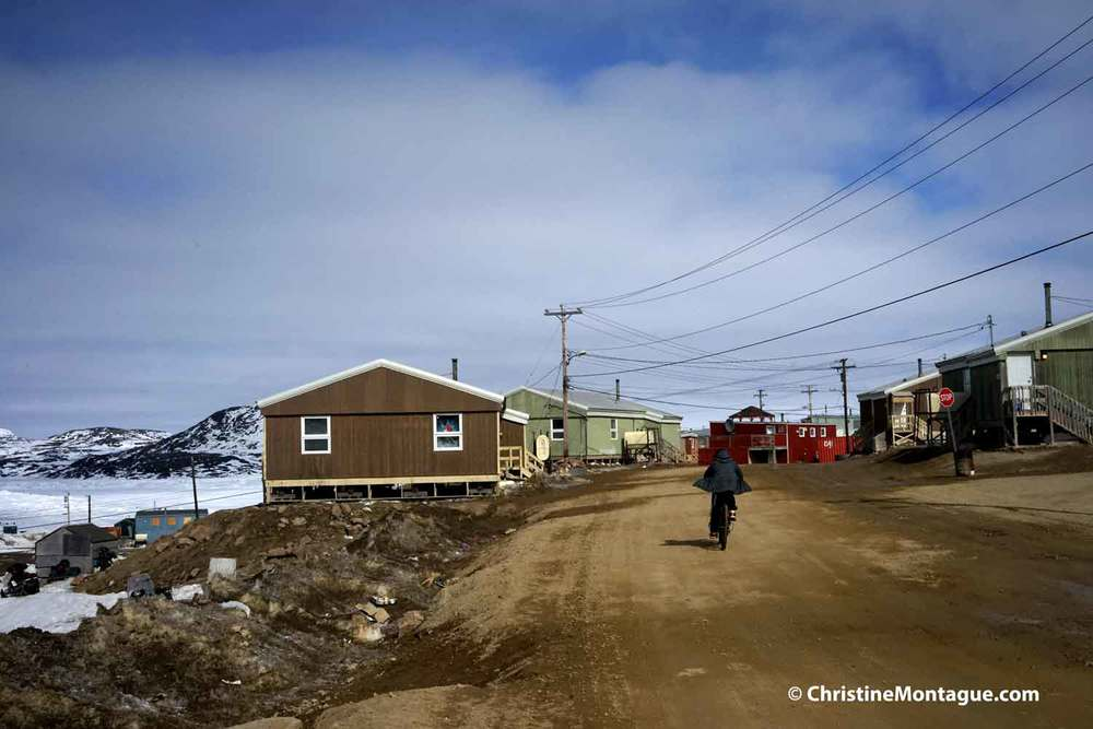 Bicyclist in Cape Dorset. Photo: ©Christine Montague