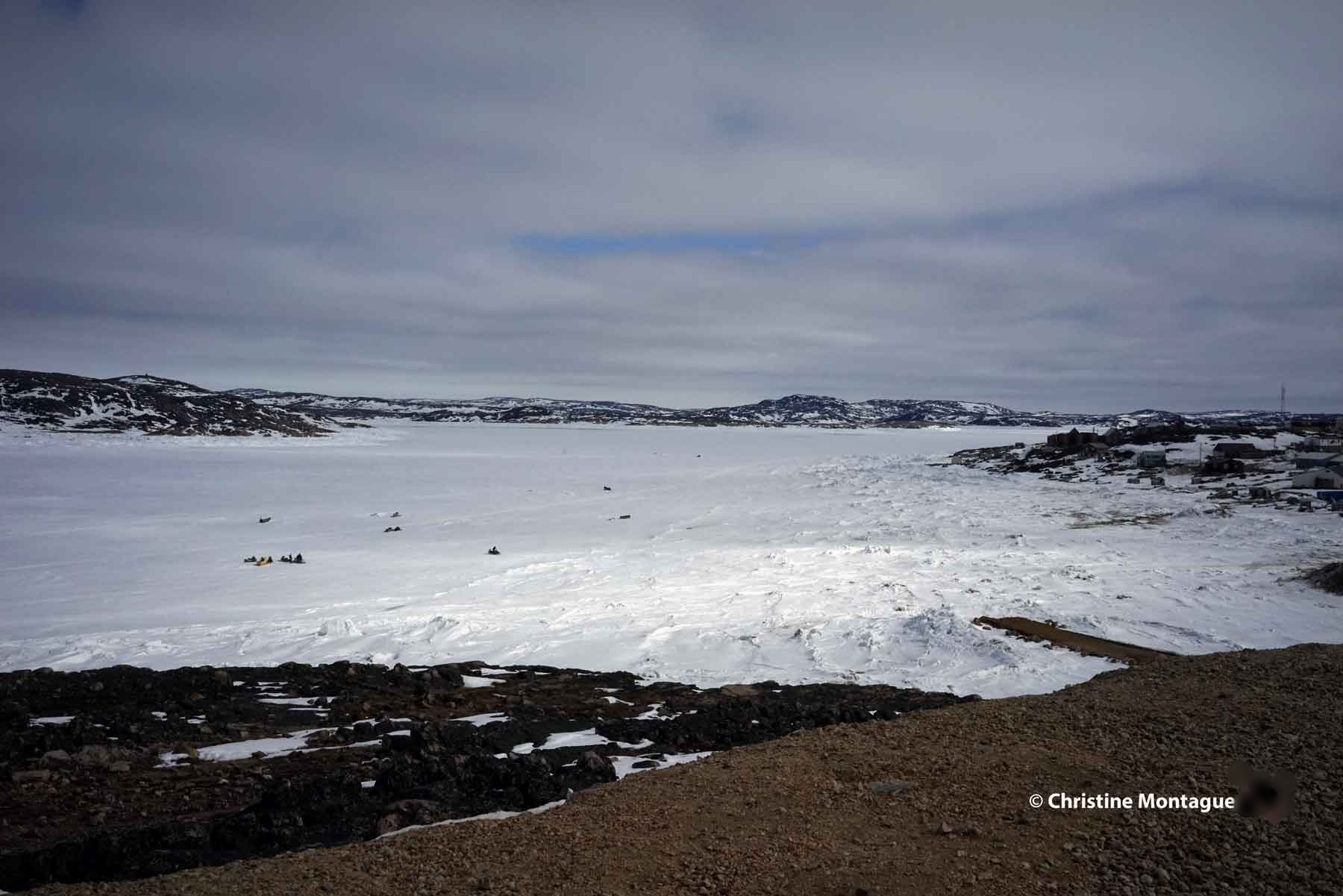 Inuit hunters head out on the land. As seen from the gazebo in Cape Dorset. Photo: Christine Montague www.christinemontague.com
