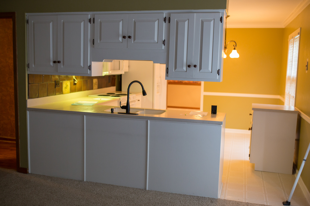 Those cabinets seem to keep the space feeling separated, we are opening this up