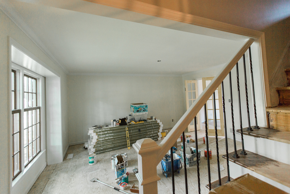 The front room used to be a dark red and has lightened up by opening the staircase and some not-quite-white paint.