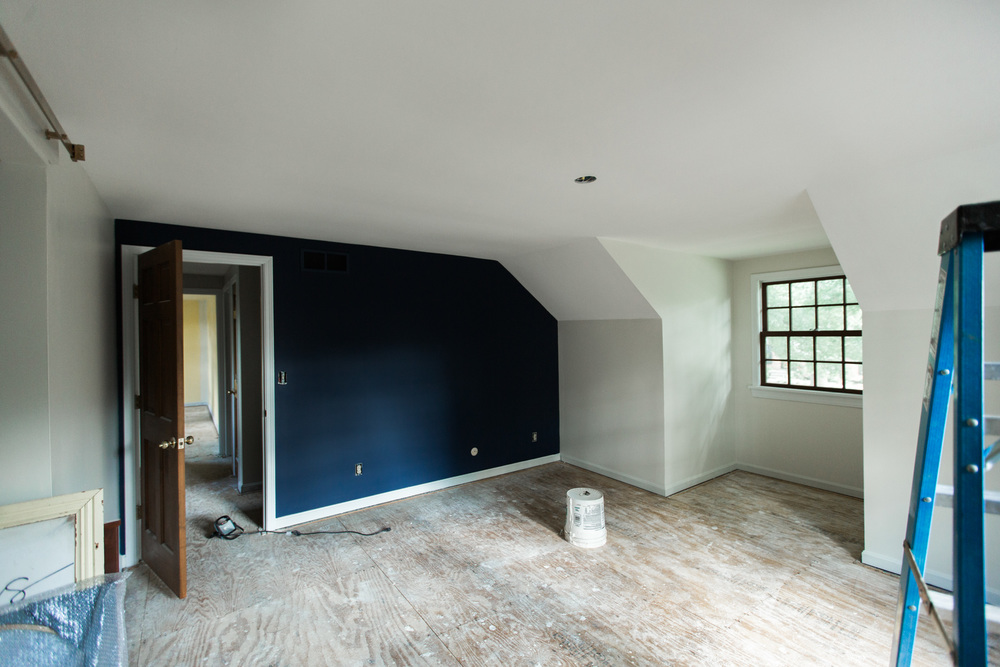 Another big change was the master bedroom with light walls and a navy accent wall.