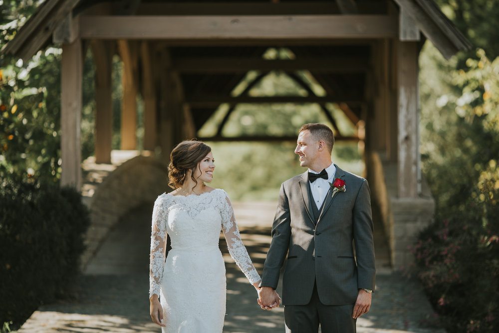 bride-and-groom-holding-hands-at-fall-wedding