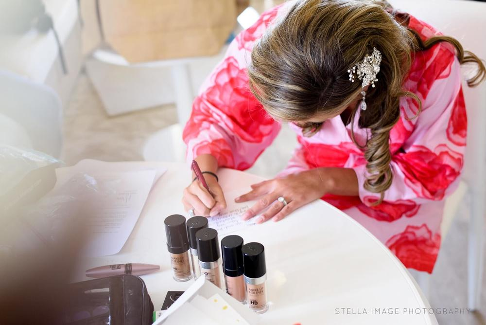 Bride writes love note to her groom before the wedding.