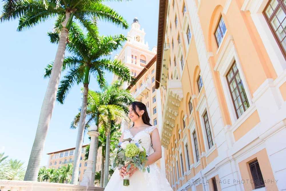 Bride poses at the front Entrance of The Biltmore Hotel Miami