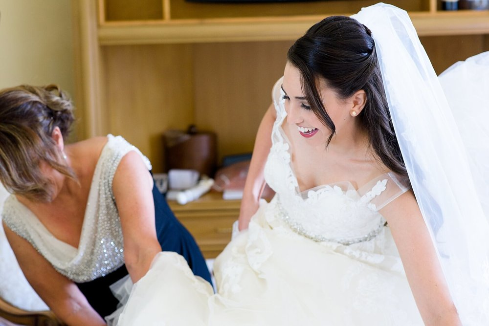 Bride getting dressed at The Biltmore Hotel Miami